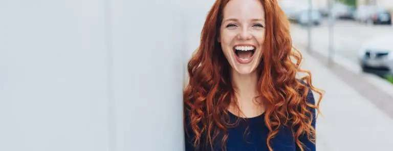 red haired lady smiling